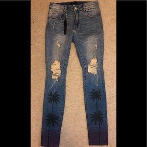Amiri men's palm tree distressed jeans